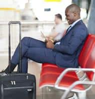 Man wearing suit at airport